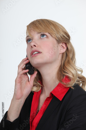 Blond office becoming stressed during telephone call
