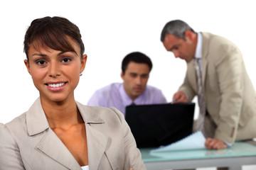 Three people having quick business meeting