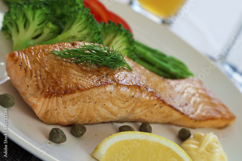 Salmon steak and cookeg vegetables