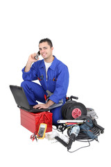 Electrician surrounded by equipment