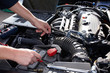 Car Mechanic Working In Auto R...