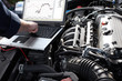 Car mechanic working in auto repair service. - 46733740