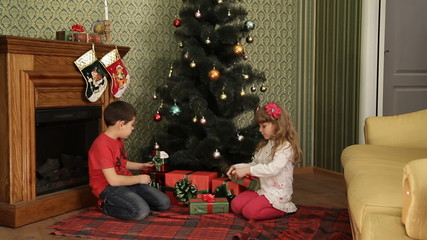 Children looking for presents on New Year