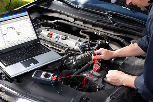 Car mechanic working in auto repair service. - 46733723