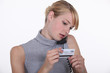 Woman with credit card and phone