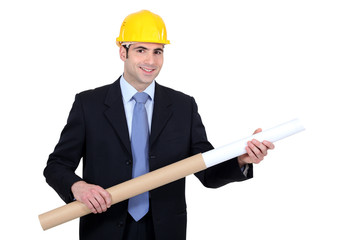 Engineer with rolled-up blueprints