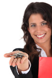 Female estate agent holding keys