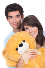 Teenagers with a large teddy
