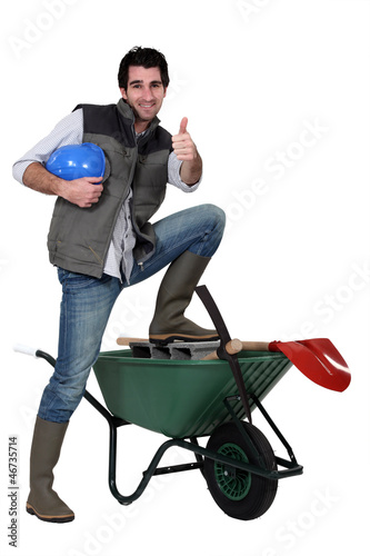 Happy building worker isolated on white background