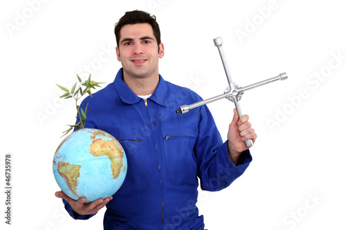 A mechanic with a globe.