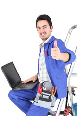 plumber with laptop and tools