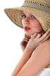 Woman posing in straw hat