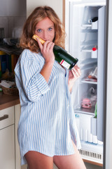 Sexy woman raiding the fridge