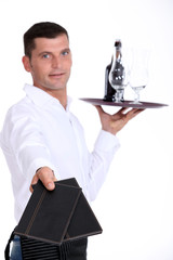 Waiter holding tray, studio shot