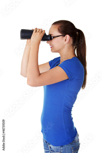 Attractive woman with binoculars
