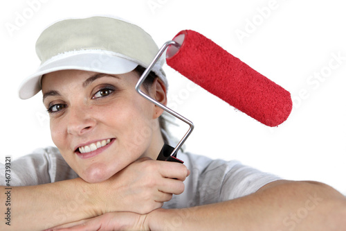 Female decorator holding paint roller