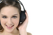 happy women listening music in headphones