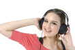 Happy young women listening music in headphones