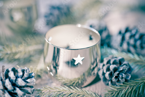 Christmas candle on a wooden background in vintage style