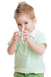 Little kid or child drinking water from glass isolated on white.