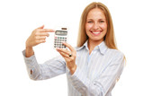 Young woman with great smile pointing at calculator
