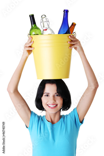 Beautiful young woman holding recycling bin