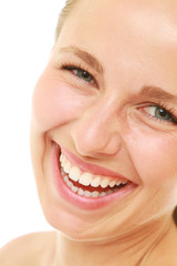 Close-up of excited young woman with healthy