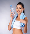 Smiling healthy woman with  bottle of water