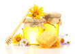 Sweet honey in jars with honeycomb, wooden drizzler and flowers