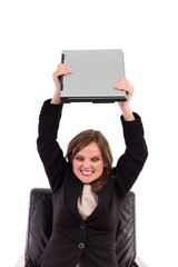 Angry businesswoman throwing her laptop