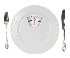 Diet meal. White plate with weight scale