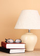 table lamp and books on beige background