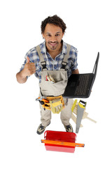 Handyman with a laptop