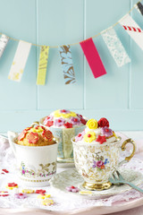 Homemade cupcakes in antique cups.