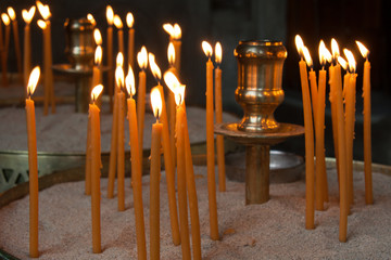 Candles lit in an Orthodox church - Cyclades
