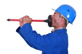 Plumber unplugging his mouth.