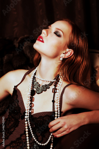 Tempting red hair woman with sensual emotions on her face