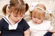 little girl reading a book sister