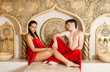young woman and young boy in a Turkish bath