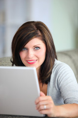 Gorgeous woman using laptop at home
