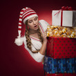 women with Santa hat with presents isolated