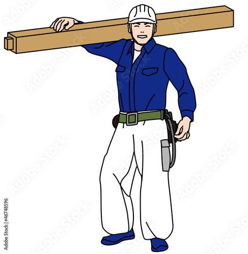 柱材を担ぐ大工さん