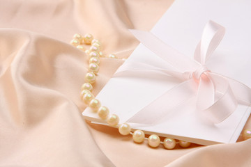 Invitation card on silk satin background.