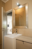 Washbasin and mirror in a little modern bathroom