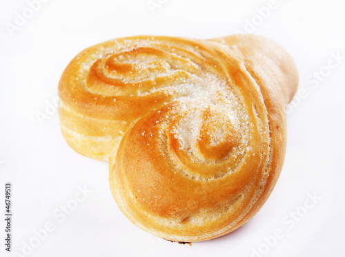 Freshly baked bun dusted with sugar