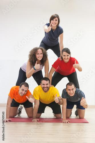 Human Pyramid and Thumbs Up