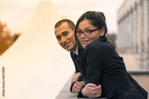 Couple of businessman and woman looking in camera outdoors.
