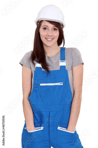 Tradeswoman standing with her hands in her pockets