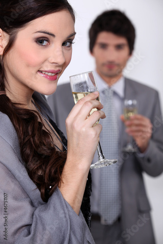 Smart couple drinking champagne