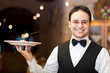 Waiter presenting food in a restaurant